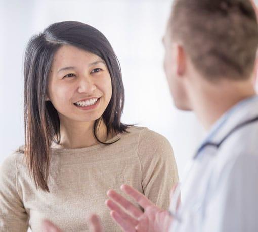 Infectious disease doctor talking to patient