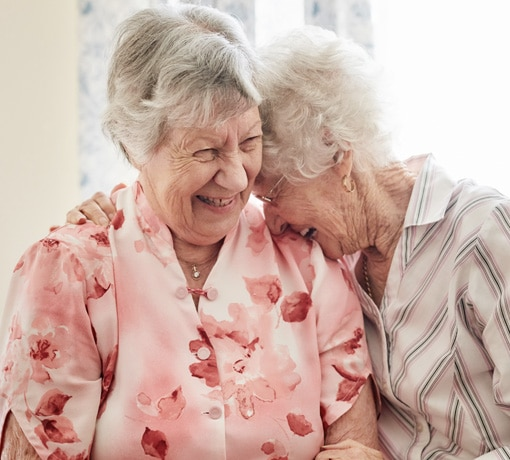 Two mature females laughing