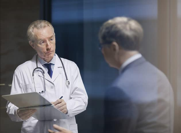 Infectious disease doctor meeting with businessman