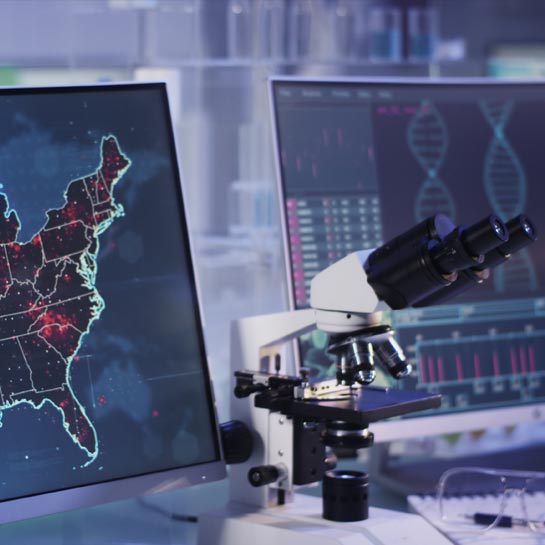 Science lab and map of infectious disease outbreak in United States