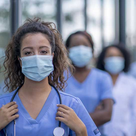 Front line health care workers looking confident